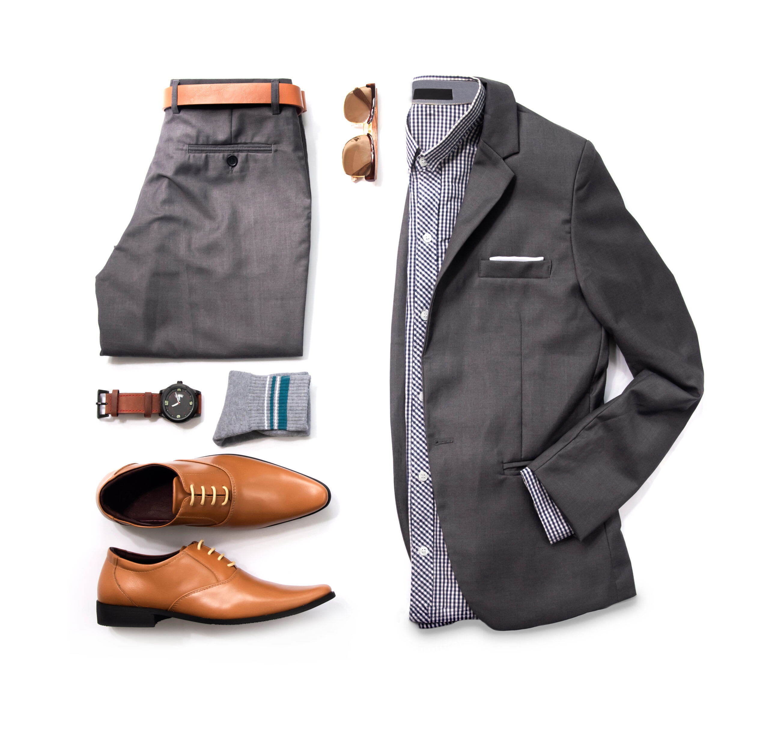 Men's casual outfits for man clothing with gray suit , watch, sunglasses, trousers, socks, shirt and oxford shoes isolate on white background, Top view. pack shot