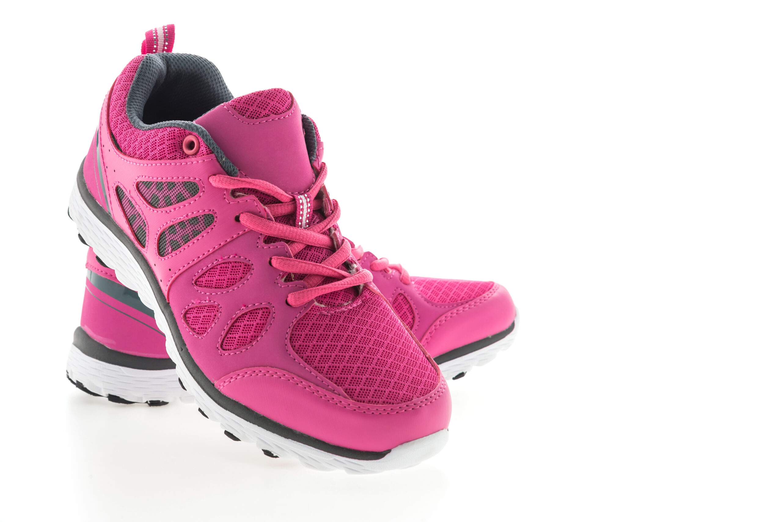 Pink Sport running shoes isolated on white background